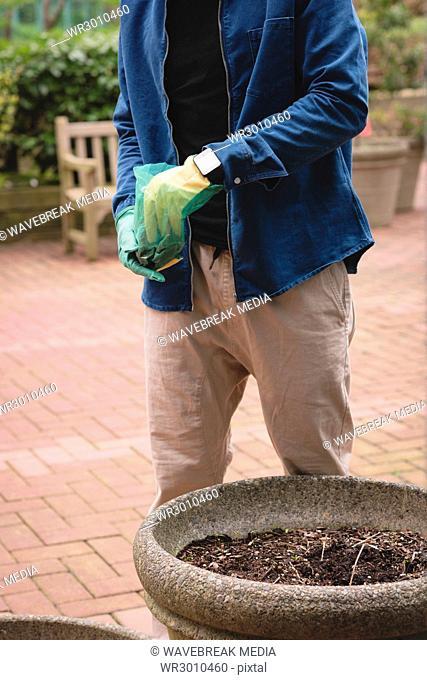 Man mixing fertilizer in soil
