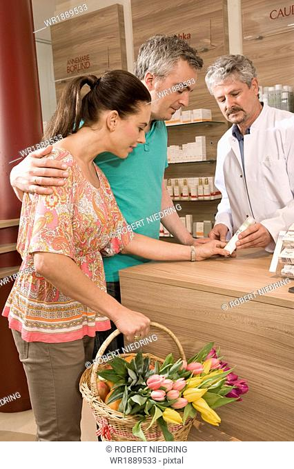 Couple In Pharmacy, Munich, Bavaria, Germany