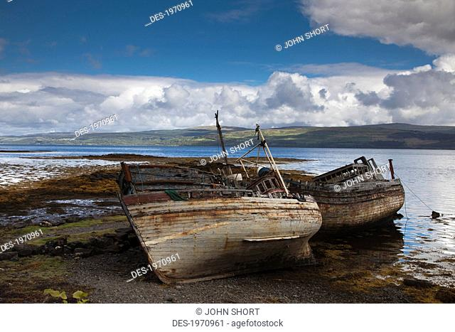 weathered boats abandoned at the water's edge, salem isle of mull scotland