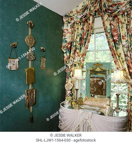 COLLECTION DISPLAYS - Antique mesh purse collection displayed on sponged green wall, floral valance and curtains, dressing table, boudoir lamps