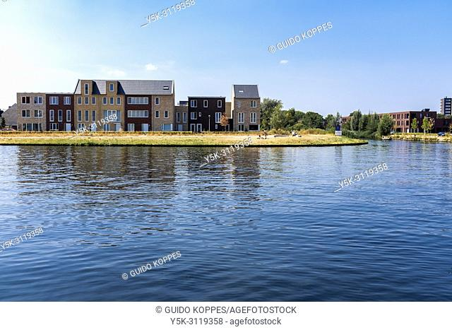 Tilburg, Netherlands. Waterway entrance to Piushaven City Harbour and view on the newly buils neighbouring neighbourhood