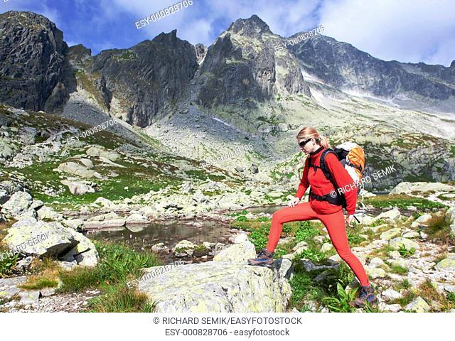 woman backpacker at Five Spis Tarns, Vysoke Tatry High Tatras, Slovakia
