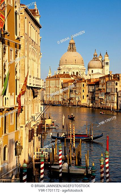 Glow of the setting sun on the Grand Canal with Santa Maria della Salute in the background, Venice Veneto Italy