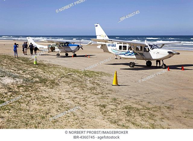 Cessna aircraft on 75 Mile Beach Road, official Highway and airfield, UNESCO World Heritage Site, Fraser Island, Great Sandy National Park, Queensland