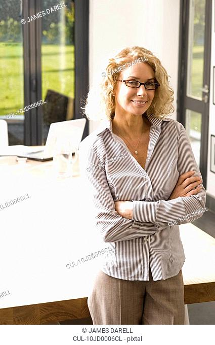 Woman at work with arms crossed