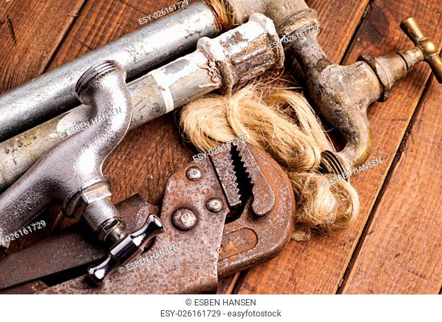 plumbing tools lying with old pipes and faucets