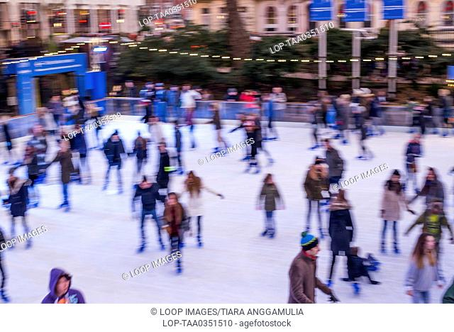 Skaters on ice rink