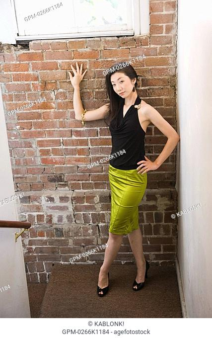 Fashionable Woman Leaning Against Window Stock Photos And