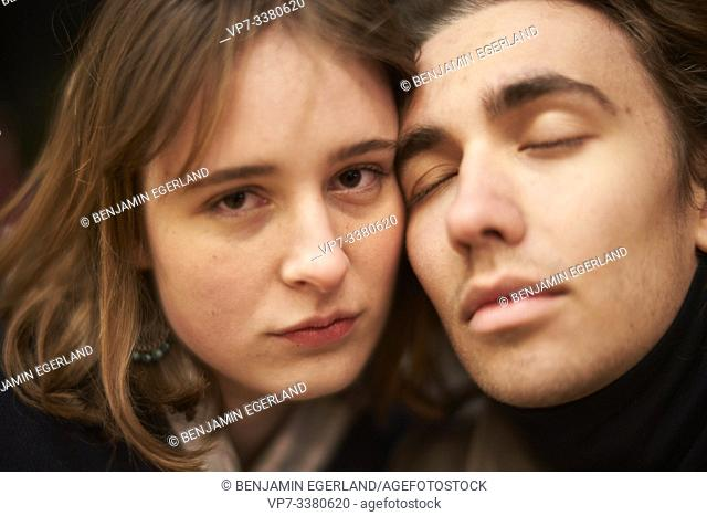 affectionate man leaning head against confident woman, in Berlin, Germany