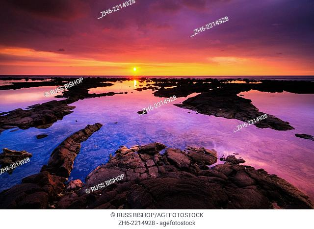 Sunset over the royal fishponds at Hapaiali'i Heiau, Kona Coast, The Big Island, Hawaii USA