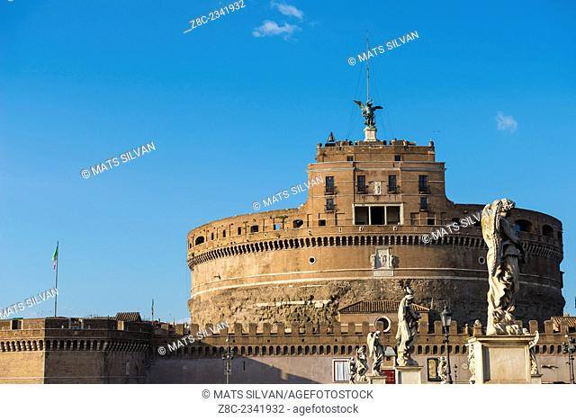 Castle sant'angelo with statue in a sunny day with blue sky in Rome, Italy
