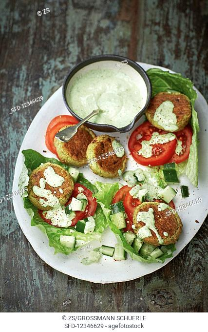 Green falafel with a coriander dip