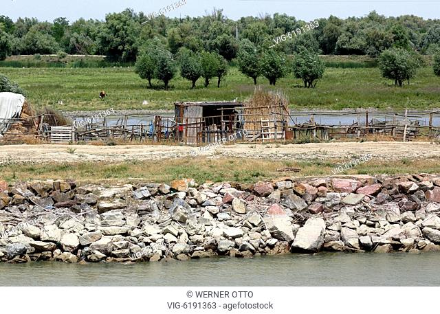 Danube landscape near Maliuc at the Sulina branch, agriculture, livestock farming, wooden hut and wooden fence, Danube river dyke, flood protection, marshland