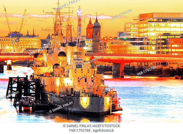 The World War Two battle-cruiser HMS Belfast moored on the River Thames near London Bridge, London, England, as a tourist attraction and pictured in a Winter...