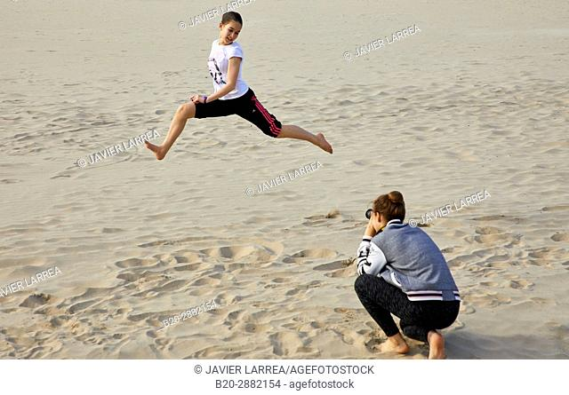Young girls in the beach, Hendaye, Aquitaine, Pyrenees Atlantiques, France