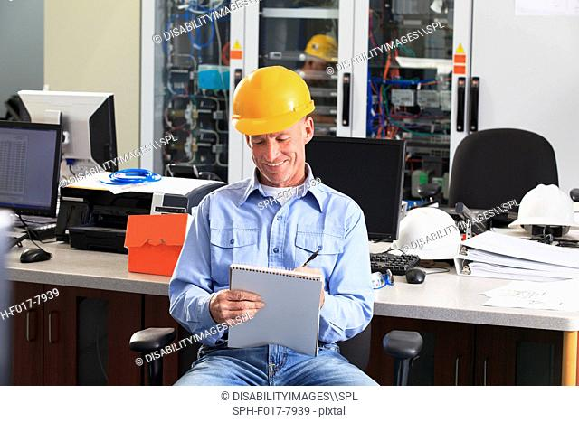 Electrical engineer working in central operations room of power plant