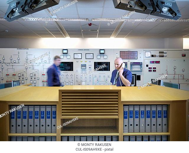 Engineers in nuclear power station control room simulator