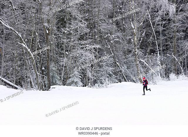 Jogging in snowy winter landscape