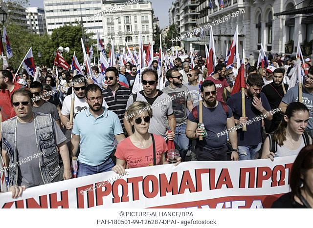 01 May 2018, Greece, Athens: Members of the pro-communist union PAME march towards the Greek Parliament. In Athens, several people took part in two separate May...