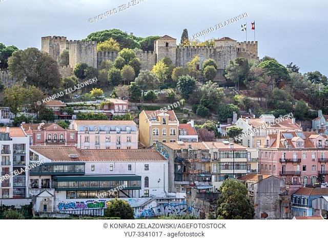 View from Rua Damasceno Monteiro street in Graca neighbourhoods of Lisbon, Portugal with St George Castle