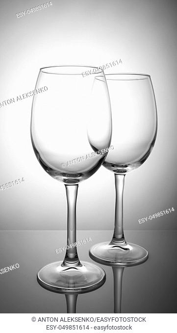 Two transparent wine glasses isolated on white background