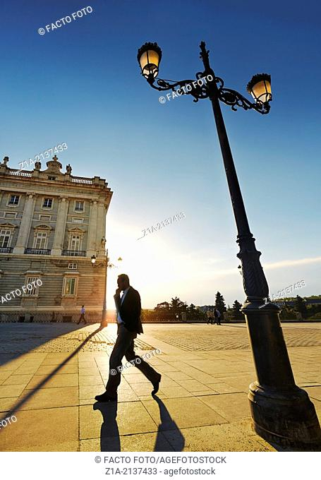 Man walking along the Royal Palace of Madrid. Spain