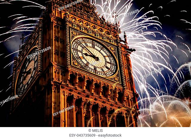 Explosive fireworks display fills the sky around Big Ben. New Year's Eve celebration background