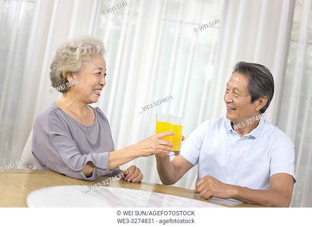 Elderly couple drinking Orange juice