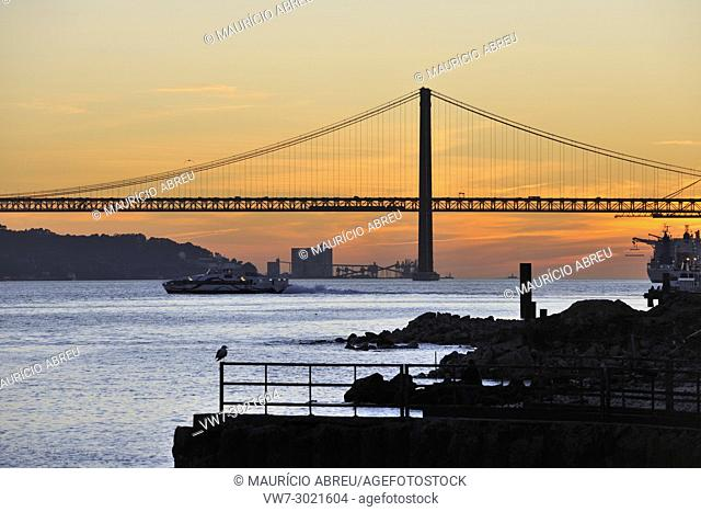 The Tagus river and Cais das Colunas at sunset. Lisbon, Portugal
