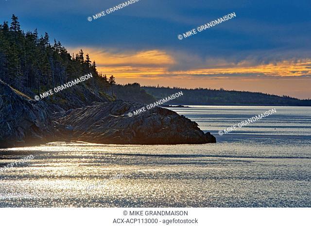 Storm light on Chedabucto Bay at sunset, Fox Island, Nova Scotia, Canada