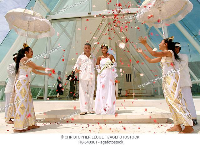 wedding couple walking trough flowers shower