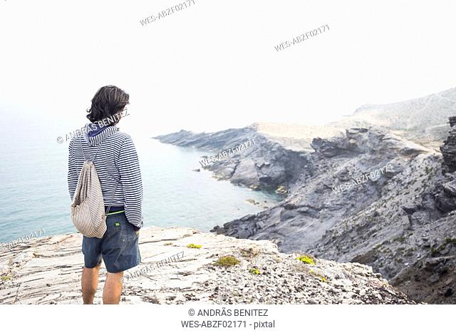 Spain, Murcia, young man looking at the sea