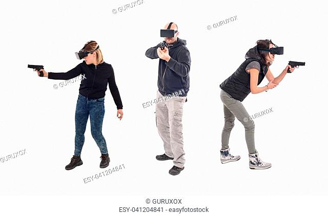Group of people having fun with virtual reality glasses. Studio shoot