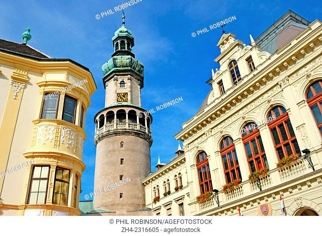 Sopron, Western Transdanubia, Hungary. 61m Fire Tower with Storno House (left) Town Hall (right) Craft Market in Fo Ter