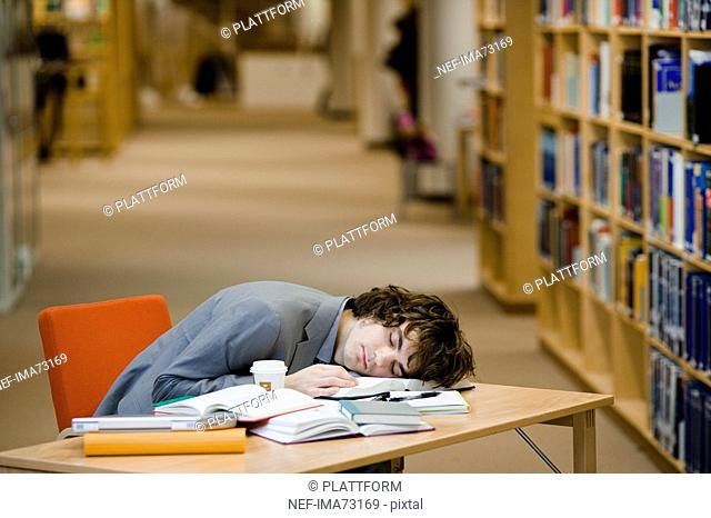 A student who has fallen asleep in a library Sweden