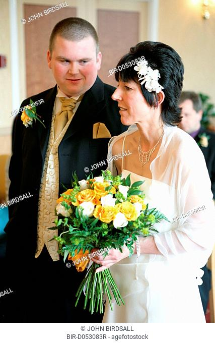 Bride and groom taking marriage vows at a registry office wedding