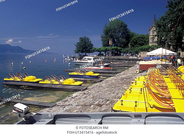 paddleboats, Switzerland, Vevey, Lake Geneva, Vaud, Yellow paddleboats docked at the lakefront park along Lac Leman in Vevey in the Canton of Vaud