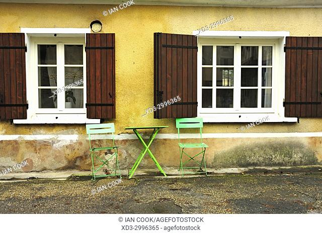 table and chairs in front of house, Issigeac, Dordogne Department, Aquitaine, France