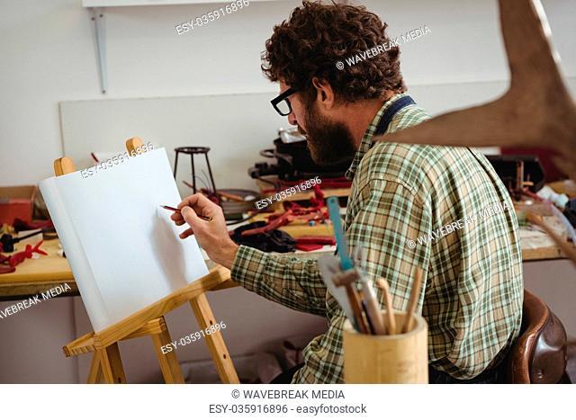 Craftsman drawing sculpture design