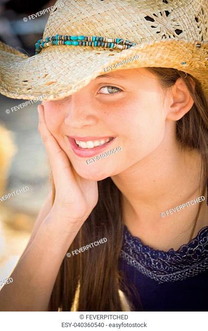 Preteen Girl Portrait Wearing Cowboy Hat in Rustic Setting