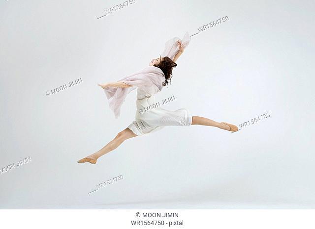 ballerina in white dress dancing
