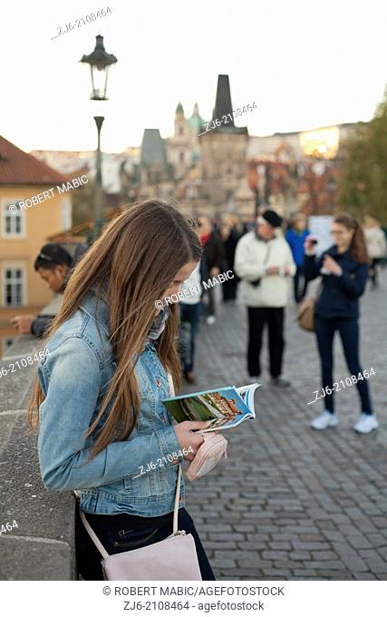 Girl with a guide. Karluv Most - Charles Bridge. Prague