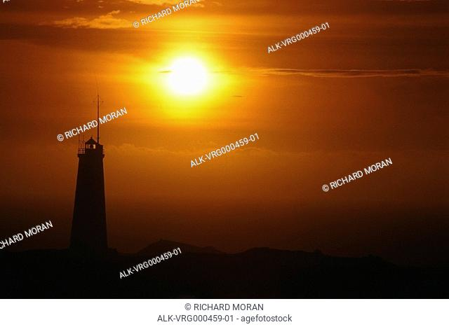 Lighthouse and sunset on the Atlantic Ocean Iceland