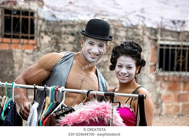 Handsome clown with muscles and hat with partner