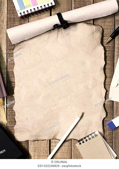 paper and stationery office equipment on wooden background