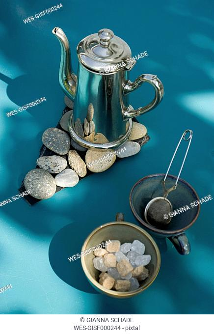 Matal tea pot on self made pebble table mat