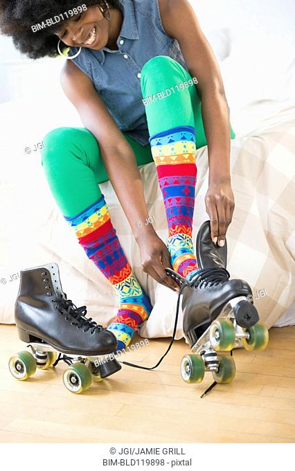 Mixed race woman putting on roller skates