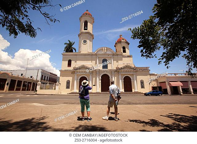 Tourists in front of the Purisima Concepcion Cathedral in Jose Marti Park, Cienfuegos, Cuba, West Indies, Central America