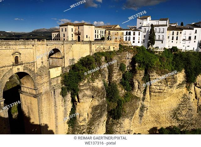 Cliff at El Tajo Canyon on the Guadalevin river with 18th century new bridge at Ronda Spain