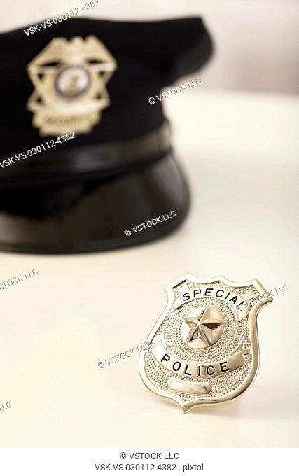 Police badge and hat
